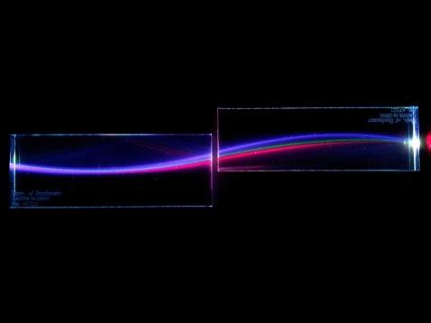 Narrow-Spectrum Gradient-Index Refraction